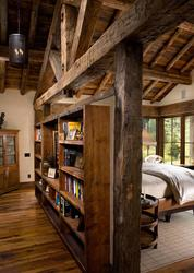 Beautiful master bedroom with reclaimed wood beams