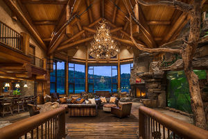 Log home great room with lake view
